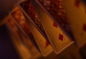 Card house in dark light